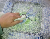 Once the grout is completely dry, use an old washcloth and rub the tiles clean, also make sure that all the excess grout is cleaned away.